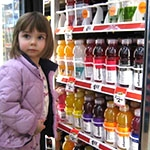 Girl in front of vending machine