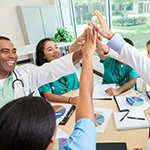 Healthcare Workers High-Fiving